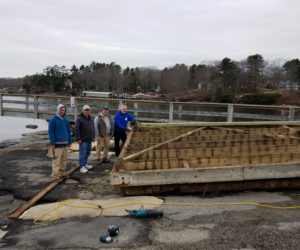 A community effort at the town landing.