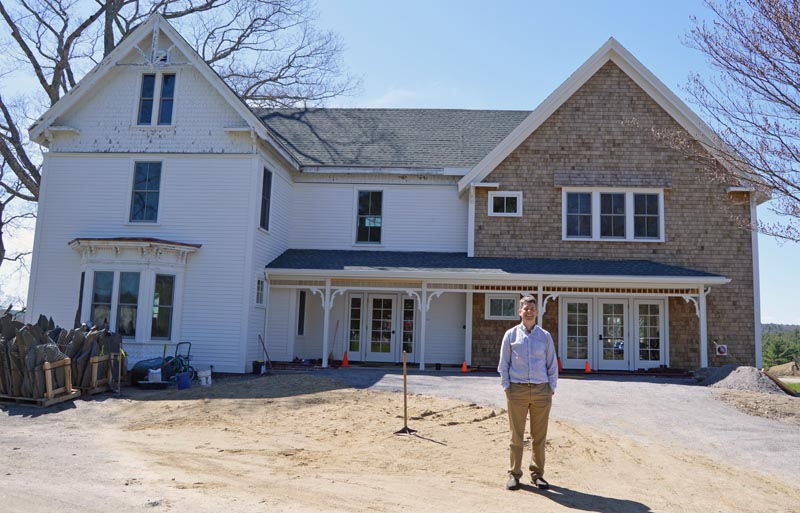 Coastal Rivers Conservation Trust Executive Director Steven Hufnagel stands in front of the newly renovated Rafter family farmhouse, the trust's new headquarters at Round Top Farm in Damariscotta. (Evan Houk photo)