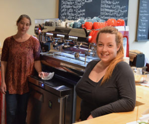 Cupacity owner Susan Murphy stands with her good friend and store operations manager Samantha Merrill at the front counter of the new coffee shop in downtown Damariscotta. Cupacity officially opened May 18. (Evan Houk photo)