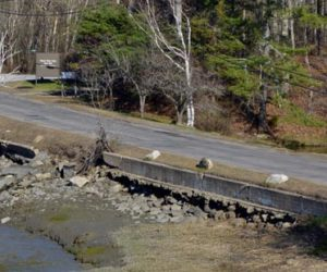 A view of Miles Street in Damariscotta from the parking lot at LincolnHealth's Miles Campus. The town of Damariscotta and LincolnHealth will split the cost to rebuild the street, build a new sidewalk, and rebuild the retaining wall. (Evan Houk photo)