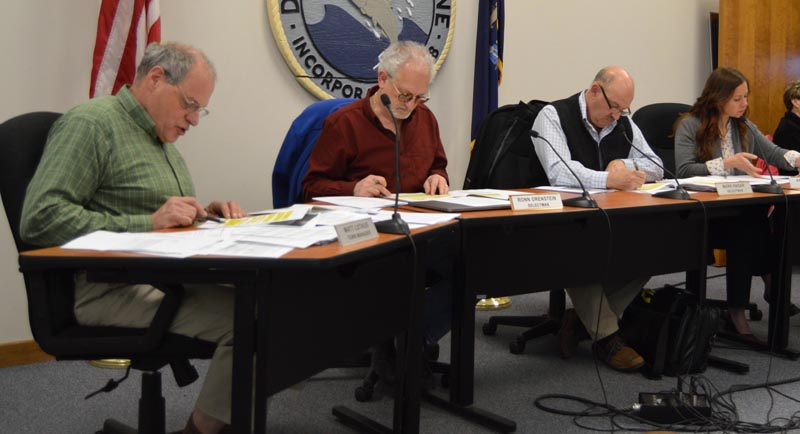 From left: Damariscotta Town Manager Matt Lutkus and Selectmen Ronn Orenstein, Mark Hagar, and Amy Leshure review draft marijuana ordinances. The selectmen voted 3-1 to approve the ordinances and bring them to public hearings in August. (Evan Houk photo)