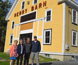 From left: Heather Webster, Ruth Davison, Stephanie McSherry, and Laroy Ellinwood outside Merry Barn. Webster and Davison are the daughter and widow of Howie Davison, who ran a dance hall in the barn; McSherry is the current owner of the barn; and Ellinwood's parents owned the barn before the Davisons. (Jessica Clifford photo)