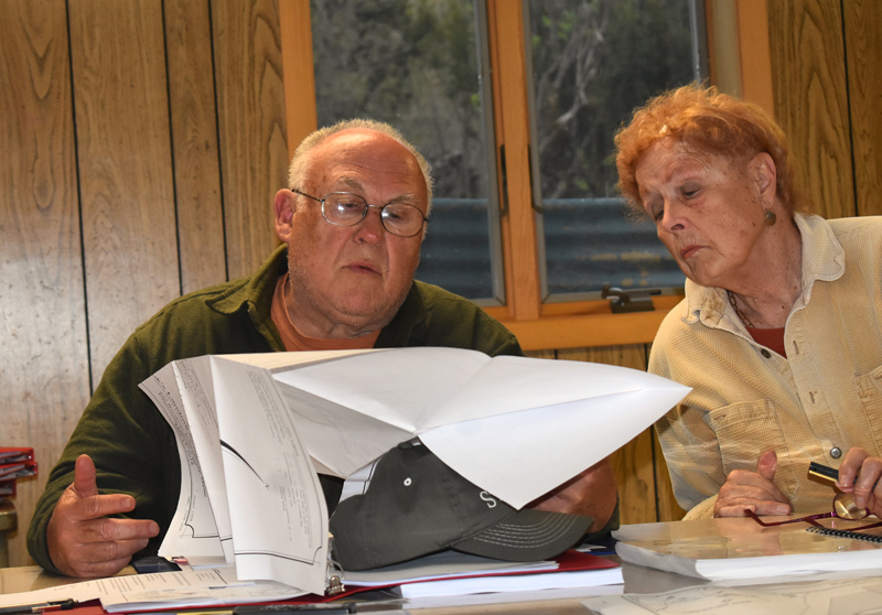 Edgecomb Planning Board Chair Barry Hathorne and Vice Chair Pat Jeremiah review documents from Cook's Landing Bar and Grille on Thursday, May 16. (Alexander Violo photo)
