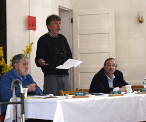Edgecomb Selectman Mike Smith speaks during annual town meeting Saturday, May 18 while Selectmen Jack Sarmanian (left) and Ted Hugger look on. (Jessica Clifford photo)