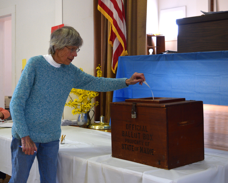 Edgecomb resident Zibette Dean casts a ballot during annual town meeting Saturday, May 18. (Jessica Clifford photo)