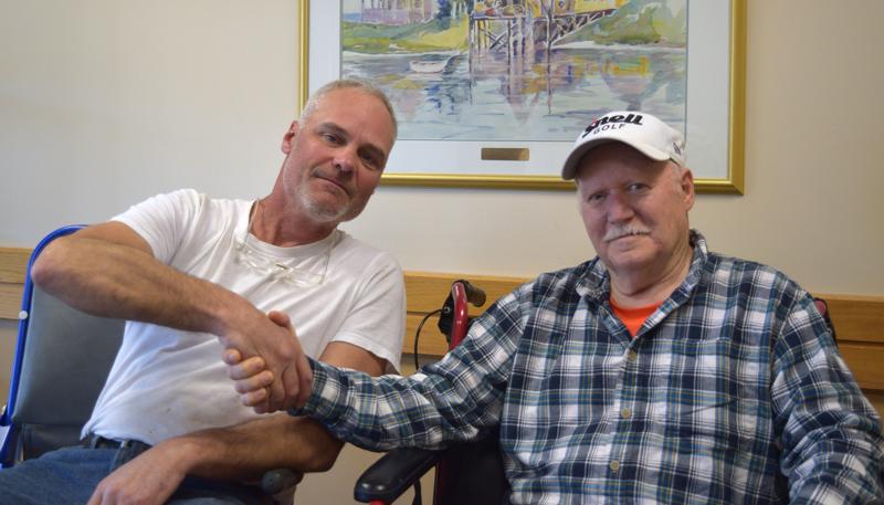 From left: David Reiss shakes hands with David Drever weeks after rescuing Drever from the cold waters of Damariscotta Lake on April 22. (Jessica Clifford photo)