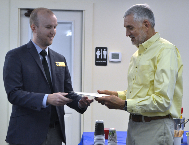 From left: Scott Wilkinson, regional representative for U.S. Sen. Angus King, presents a certificate of recognition to Lincoln County Planner Bob Faunce during Faunce's retirement party at the Lincoln County Regional Planning Commission in Wiscasset on May 15. (Charlotte Boynton photo)