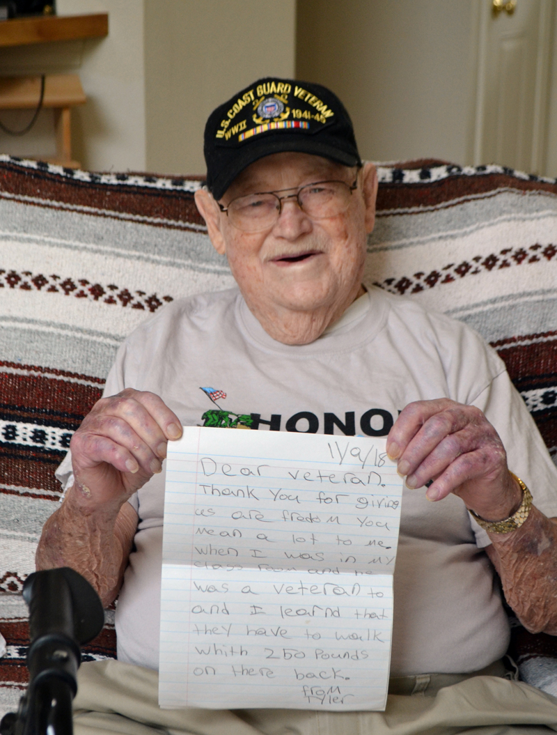 World War II veteran Eugene Walsh, 102, of Newcastle, holds a letter from a student thanking him for his service. He received the letter upon his return from an Honor Flight Maine trip to Washington, D.C. (Charlotte Boynton photo)