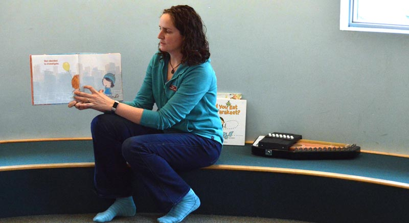 "Jessie Trafton, children's librarian at Skidompha Library, reads to toddlers during her children's story time at the library Tuesday, April 30. Trafton will host ""Reading is Magic,"" a new program on Lincoln County Television. (Evan Houk photo)"