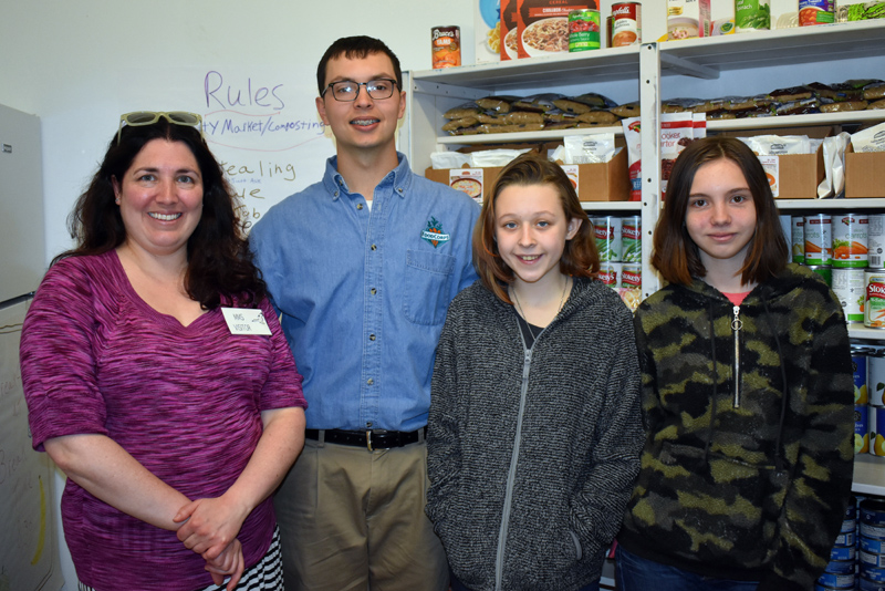 From left: Sarah Skovran, of the Area Interfaith Outreach Food Pantry; Jared Grenier, FoodCorps service member; and Medomak Middle School seventh graders Lillian Peirce and Angel Grierson inside Medomak Middle School's Community Market. (Alexander Violo photo)