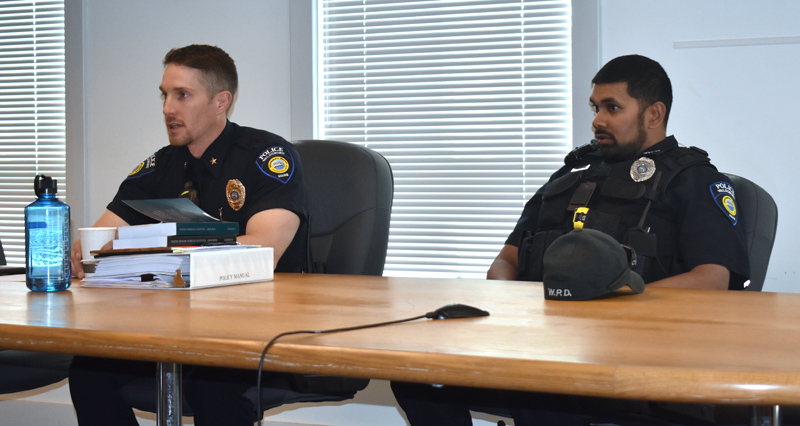 Waldoboro Police Chief John Lash (left) and Officer Nathaniel Jack host a question-and-answer session at the municipal building the evening of Wednesday, May 22. (Alexander Violo photo)
