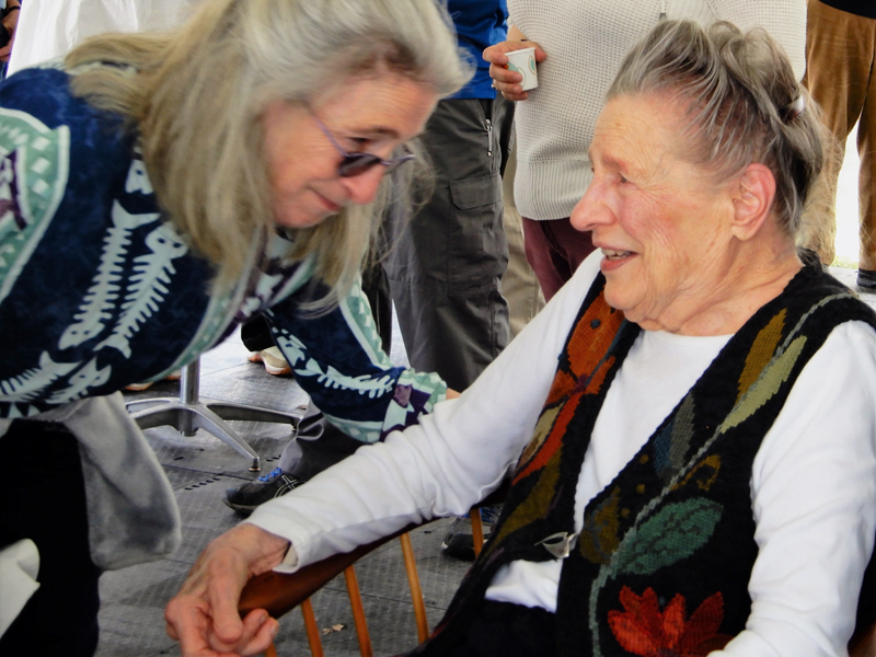 Jerry Day Mason (right) shares a moment with her daughter, Jody Brown, of Wiscasset, during Mason's 100th birthday party at her Westport Island home May 4. (Photo courtesy Gaye Wagner)