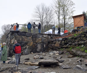 Visitors explore the former Coopers Mills Dam site after the dedication Monday, May 20. The base of the overlook incorporates stone from the dam. (Jessica Clifford photo)