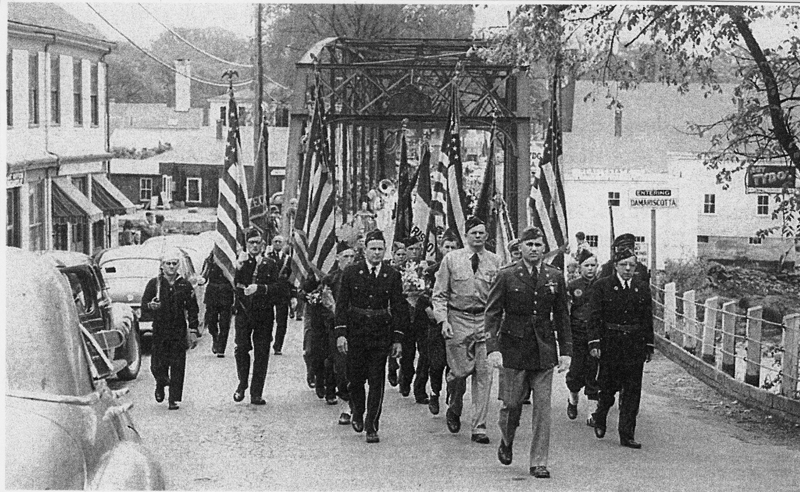A Memorial Day parade crossing the street from Damariscotta into Newcastle. Dick Day leads the parade. (Photo courtesy Marjorie and Calvin Dodge)