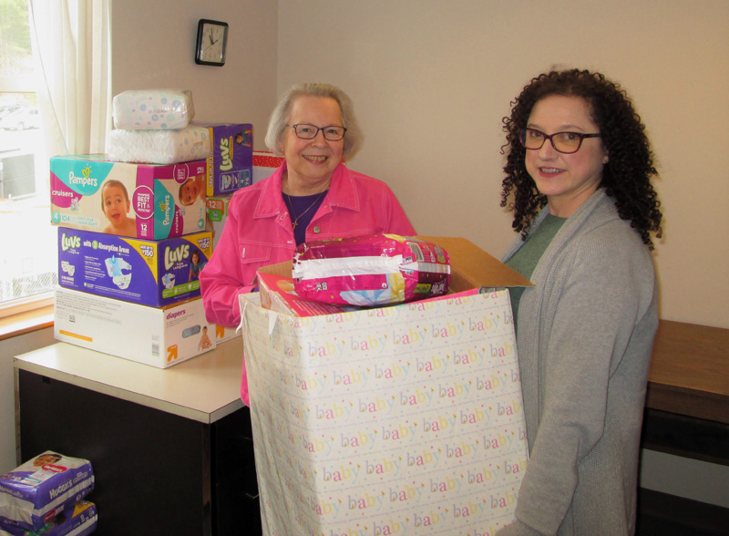 Diaper bank managers Cathy Hopkins and Susan Rockwood prepare for the annual diaper drive.