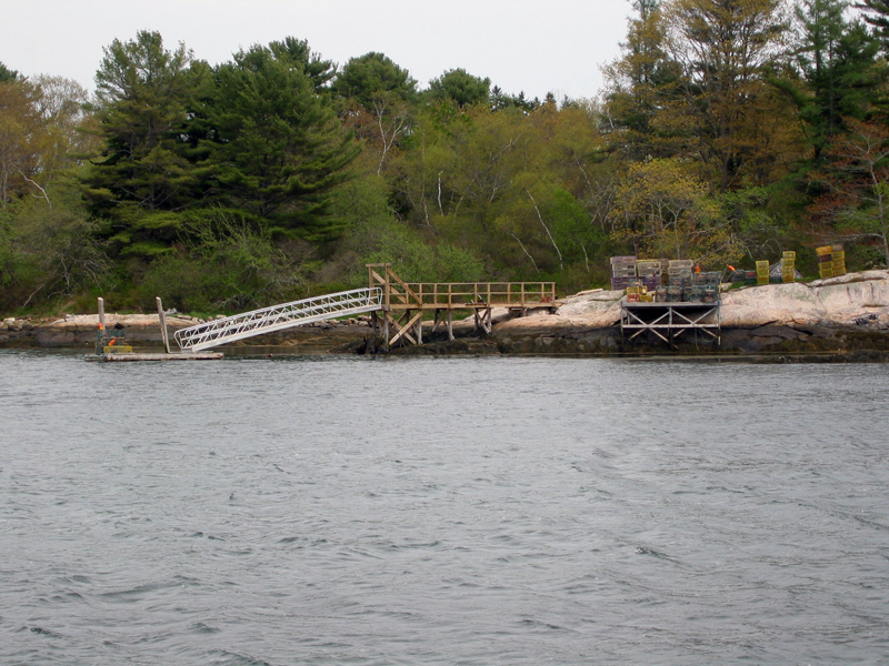Robert's Wharf is one of several locally conserved sites that support the working waterfront. Boothbay Region Land Trust partners with local lobstermen to store traps and access the water.