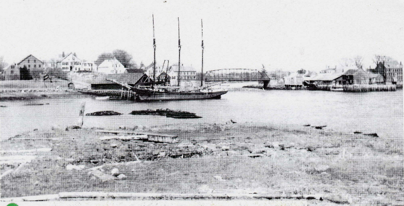 A ship docked at T.E. Gay's coal sheds, Newcastle, 1912.
