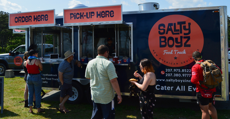 A crowd gathers in front of the Salty Boyz Food Truck at Popham Beach State Park in Phippsburg on Sunday, June 23. The truck will be open at Popham from 9 a.m. to 3 or 4 p.m. every day until Labor Day. (Evan Houk photo)