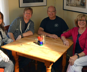 From left: The new owners of the Damariscotta River Grill, Tamara Dica and Tim Beal, sit with the Grill's founders, Rick Hirsch and Jean Kerrigan, at a corner table of the restaurant. Beal and Dica say nothing will change at the Grill, which will reopen for business as usual Thursday, June 13. (Evan Houk photo)