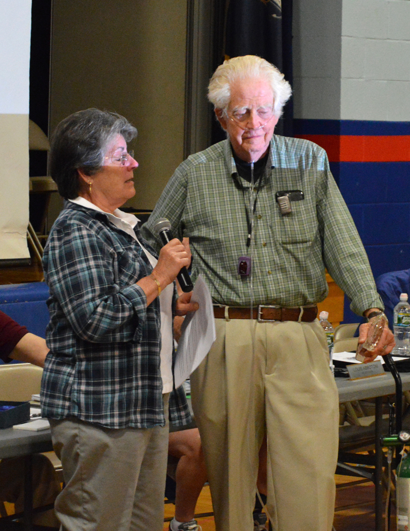 "Damariscotta Board of Selectmen Chair Robin Mayer presents Robert ""Haas"" Tobey with Damariscotta's Spirit of America Award for volunteerism at annual town meeting June 12. (Evan Houk photo)"