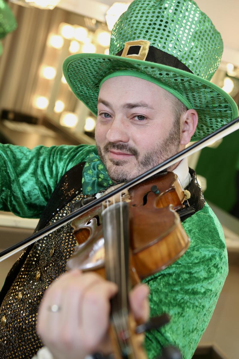 Damon Leibert in full fiddle-playing leprechaun mode. (Photo courtesy Damon Leibert)