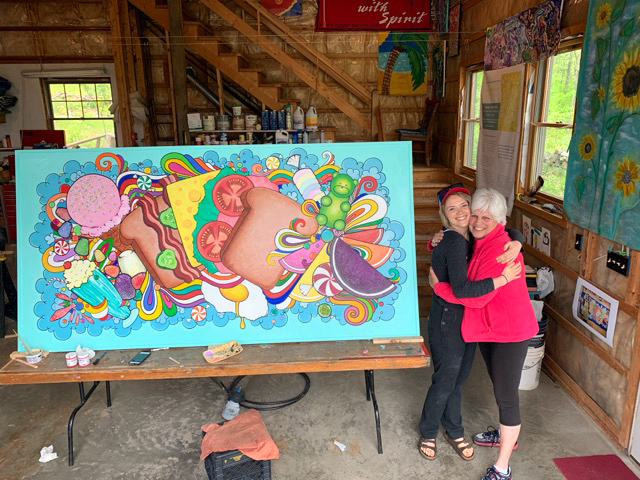 Katie Riley and Edgecomb artist Brady Nickerson celebrate the completion of Riley's mural, to be installed at S. Fernald's Country Store in Damariscotta. (Photo courtesy Brady Nickerson)