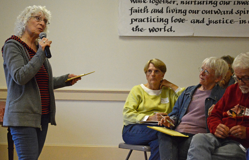 Mary Voskian, of Helping Hands for Immigrants, Refugees, and Asylum-Seekers, speaks to a crowd of nearly 50 people at The Second Congregational Church in Newcastle on Thursday, June 20. (Evan Houk photo)