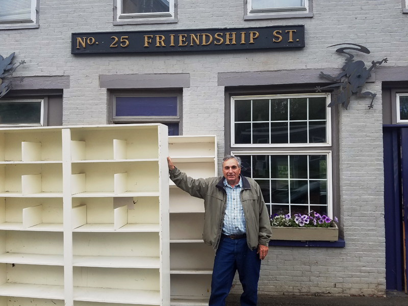 Ron Phillips, of Waldoboro, donates bookcases for the Waldoboro Public Library's new secondhand bookshop. (Photo courtesy Cathrina Skov)