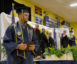 Kevin White returns to his seat after receiving his diploma during Medomak Valley High School's graduation ceremony Wednesday, June 12. (Maia Zewert photo)