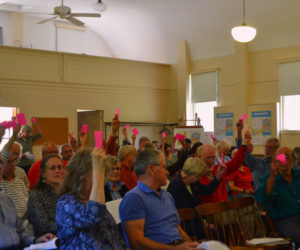 Westport Island voters approve $465,000 for the first phase of a long-term roads plan during annual town meeting at the historic town hall Saturday, June 22. (Charlotte Boynton photo)