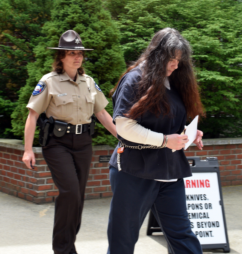 Lincoln County Sheriff's Deputy Julie Groleau escorts Shawna L. Gatto out of the Lincoln County Courthouse in Wiscasset after Gatto's sentencing Tuesday, June 25. Gatto was sentenced to 50 years in prison for the murder of her fiance's 4-year-old granddaughter. (Jessica Clifford photo)
