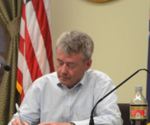Wiscasset Town Manager John O'Connell takes notes during a selectmen's meeting at the town office Tuesday, June 4. O'Connell is now the permanent town manager after four months in an interim role. (Charlotte Boynton photo)