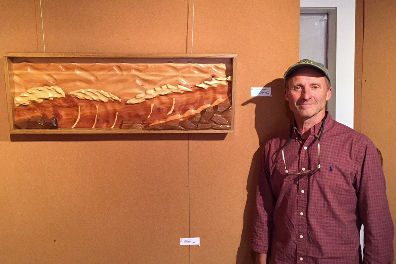 Artist Carl Solberg, of Waldoboro, stands next to one of his wood sculptures currently on exhibit at the Maine Coastal Islands NWR Visitor Center, 9 Water St. in Rockland. Solberg will talk about his work on Wednesday, July 10 at 6:30 p.m. The exhibit runs through July 19.
