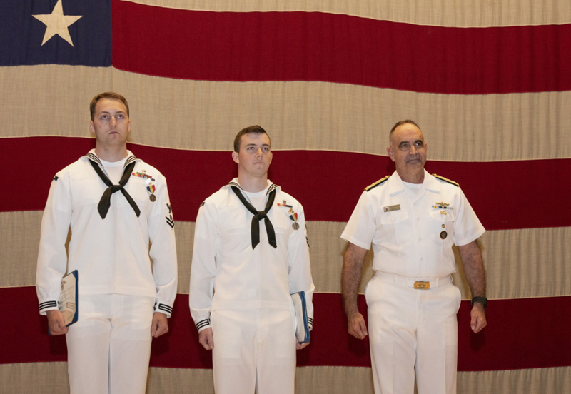 "From left: Navy Diver 2nd Class Thomas E. Parhiala Jr. and Navy Diver 2nd Class John E. McLeod, of Wiscasset, are awarded the Navy and Marine Corps Medal for their 2018 rescue of a motorist from an icy lake in Rockport. Vice Adm. Charles ""Chas"" Richard presented the medal. (Photo courtesy U.S. Navy/Petty Officer 1st Class Steven Hoskins)"