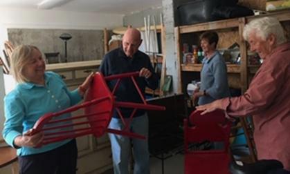 From left: Summer fair committee members Karen Hammond, Roger Sandler, Priscilla House, and Donna Plummer get ready for the gigantic yard sale.