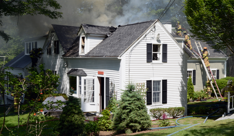 Firefighters attack a house fire from both sides at 26 Logan Road in Boothbay Harbor the morning of Tuesday, July 16. (Evan Houk photo)