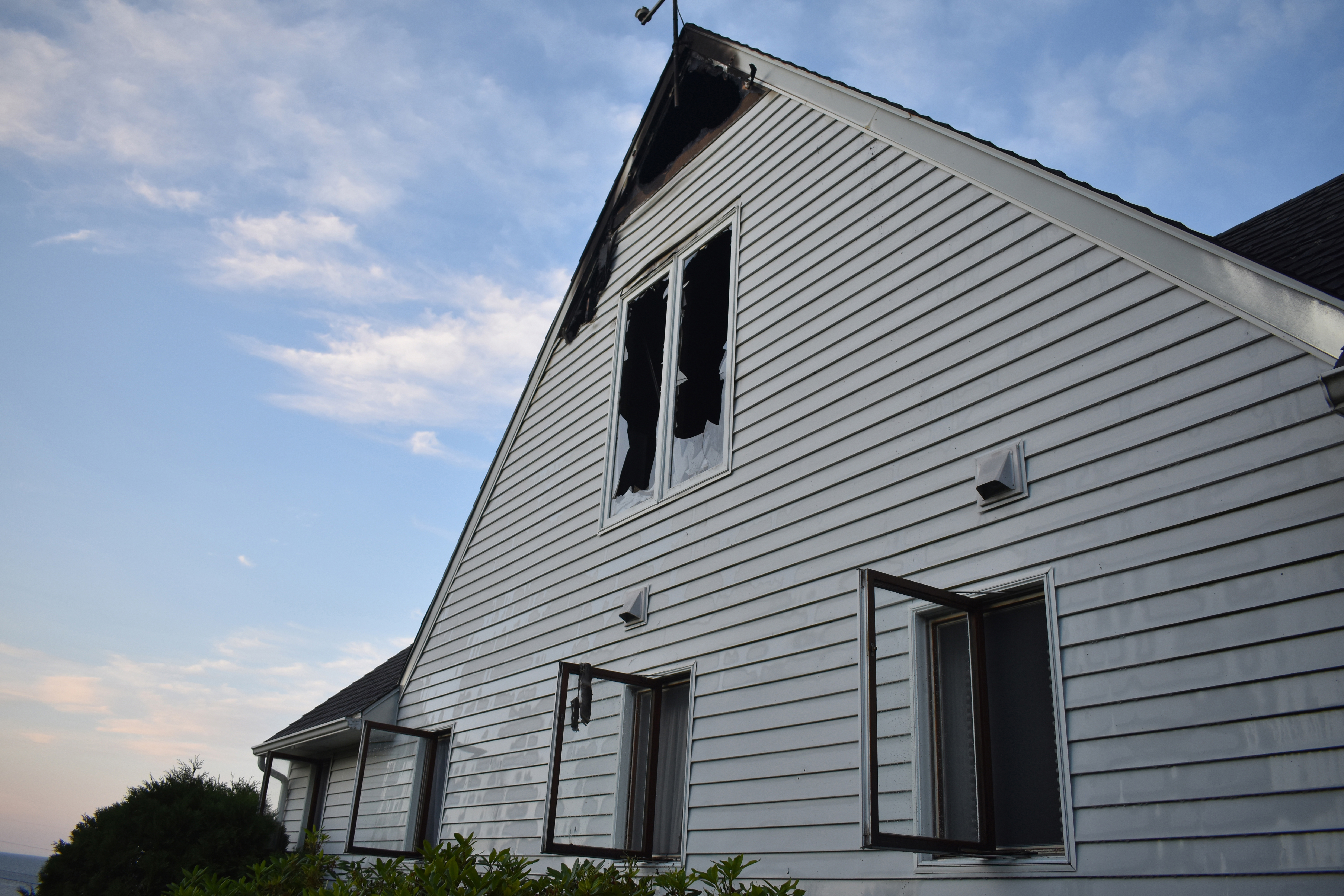 Fire damage is visible on an upper level of a home near Pemaquid Point in New Harbor early Monday, July 15. (Alexander Violo photo)