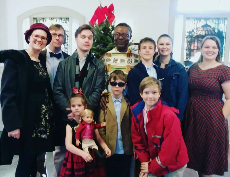 Mary Catherine Eddyblouin (far right) with her family and Fr. Dominic Azagbor, of the Dominican Order, at St. Patrick's Church in Newcastle. (Jessica Clifford photo)