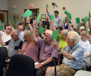 About 59 Damariscotta voters approve a funds transfer from surplus for the Bristol Road sidewalk project during a special town meeting at the town office Wednesday, July 10. (Evan Houk photo)