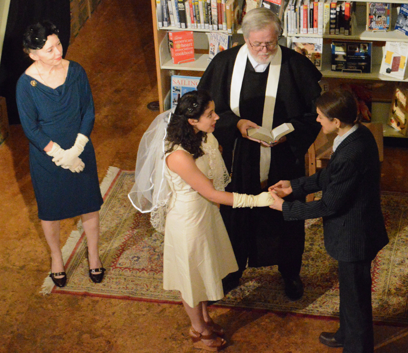"The eventual happy ending of the River Company production of ""Much Ado About Nothing"" at Skidompha Library on July 26 is a wedding between Rachel Kaplan's Hero (left foreground) and Amy Holt's Claudio (right foreground). Christine Anderson (back left), portraying Donna Leonora, Hero's mother, and the Friar, played by Michael Powers (back right), look on. (Evan Houk photo)"