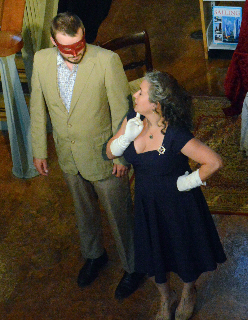 "Ben Meader's deadpan Benedick spars with Jessica DeLisle's sharp-tongued Beatrice during the masquerade scene in the River Company production of ""Much Ado About Nothing"" at Skidompha Library on Friday, July 26. (Evan Houk photo)"