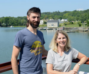 Chef Jon Merry and owner Eleanor Kinney stand on the deck of their new restaurant, River House, on the Damariscotta River next to the Twin Villages bridge in Damariscotta. (Evan Houk photo)