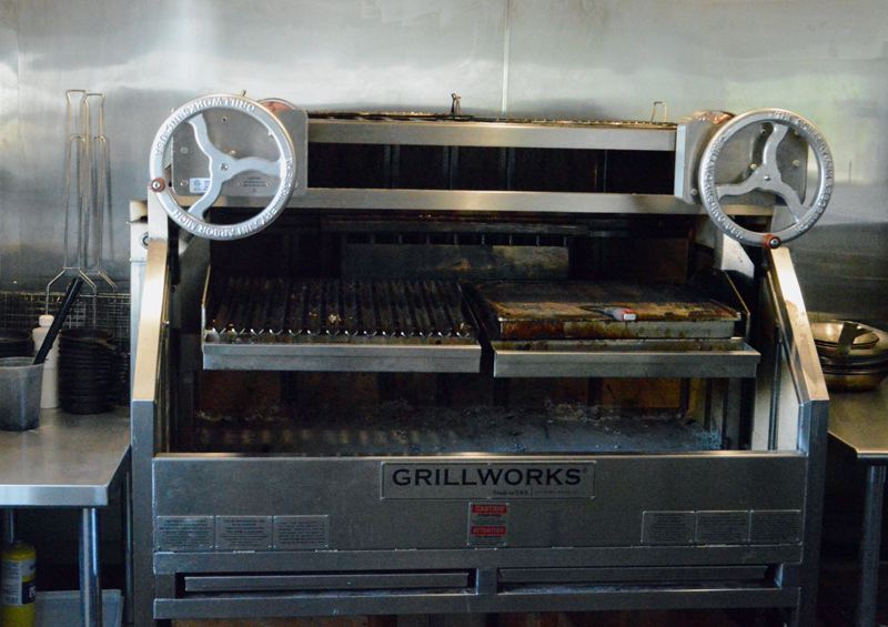 The wood-fired grill in the kitchen of the River House, the new farm-to-table restaurant beside the Twin Villages bridge in Damariscotta. Chef Jon Merry says the grill is a unique instrument for a kitchen to use. (Evan Houk photo)