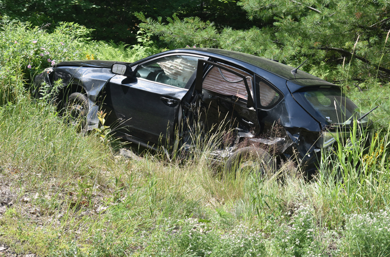 A Subaru Impreza off Cross Road in Edgecomb after a collision at the intersection with Route 1 on Sunday, July 14. (Alexander Violo photo)