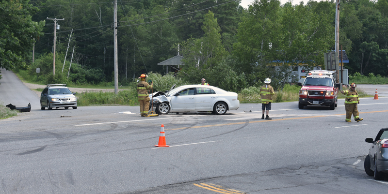 The Edgecomb Fire Department conducts traffic control at the scene of a three-vehicle crash at the intersection of Cross Road and Route 1 in Edgecomb on Sunday, July 14. (Alexander Violo photo)