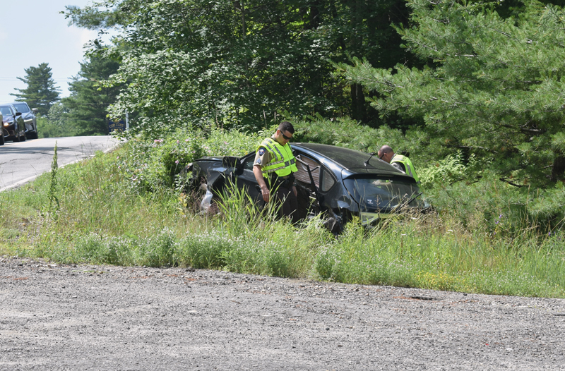 Lincoln County sheriff's deputies investigate a three-vehicle collision in Edgecomb on Sunday, July 14. (Alexander Violo photo)