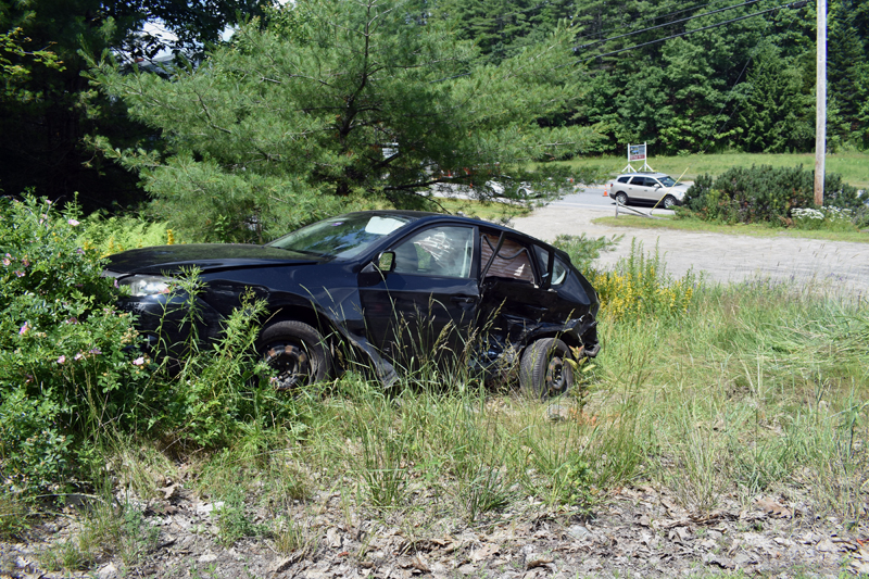 A Subaru Impreza in the brush off Cross Road in Edgecomb after a three-vehicle crash at the intersection with Route 1 on Sunday, July 14. (Alexander Violo photo)