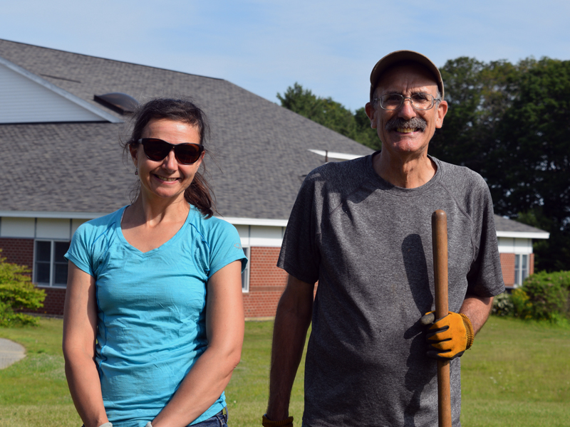 Boothbay Harbor Rotary Club members Ingrid Merrill and Bill Prince volunteer at the Edgecomb Eddy School and Family Garden. Merrill organized the effort to revitalize the garden, while Prince has lent his gardening expertise. (Jessica Clifford photo)