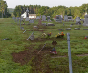 A car ran over the fence and several gravestones at Fairview Cemetery on Washington Road in Jefferson the night of Friday, July 19. (Paula Roberts photo)