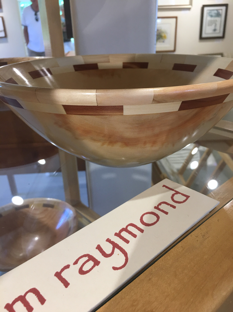 Wood artist Tom Raymond's bowl, made from box elder from his yard, graces a display stand at Saltwater Artists Gallery in Bristol. (Christine LaPado-Breglia photo)